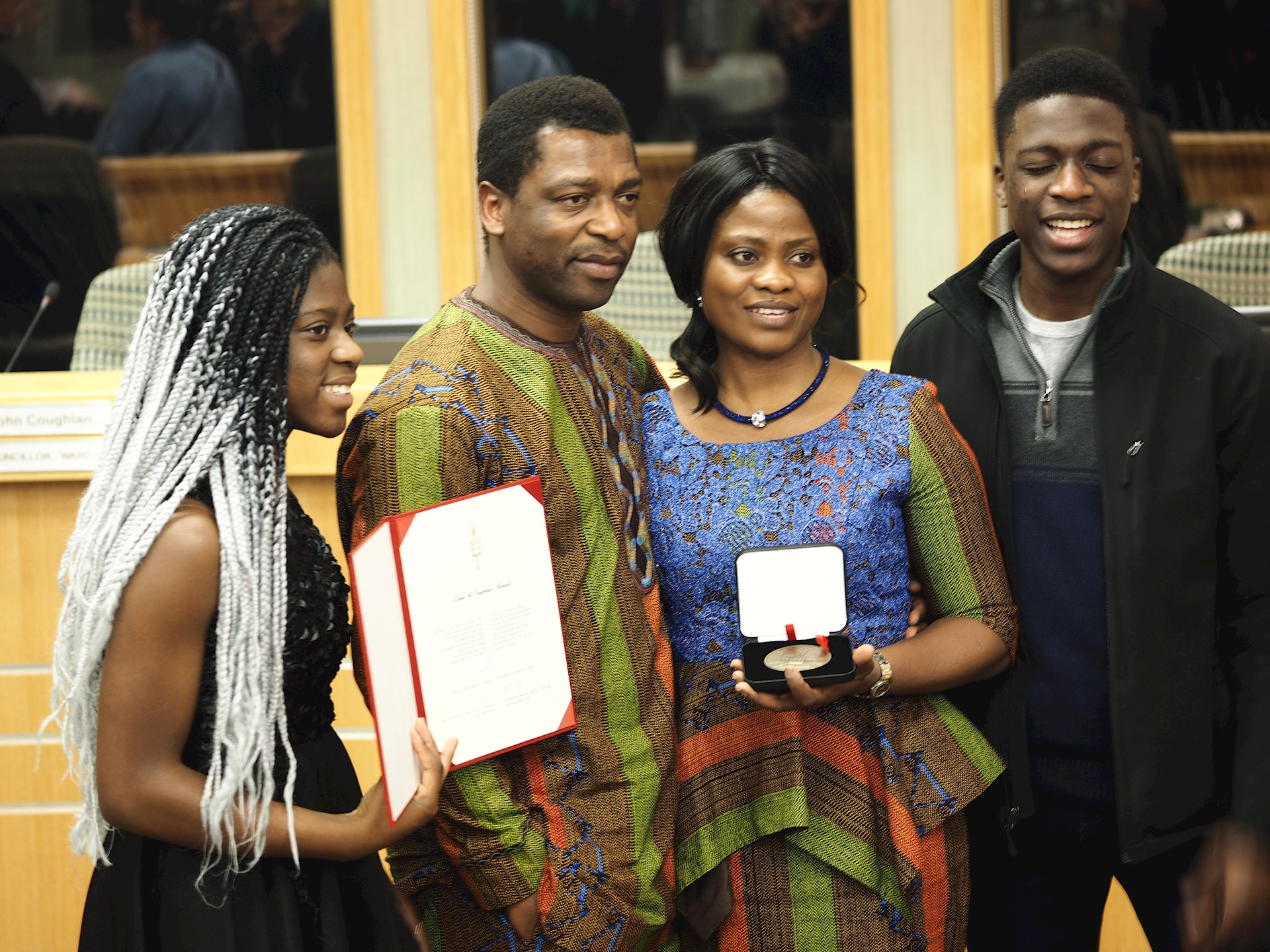 Dr. Olugbenga and Olabisi Adenuga with family, receiving their Senate Medal for volonteerism.